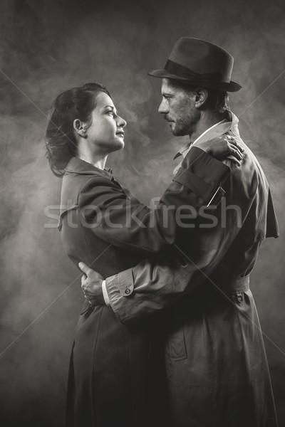 Film noir: romantic couple embracing Stock photo © stokkete