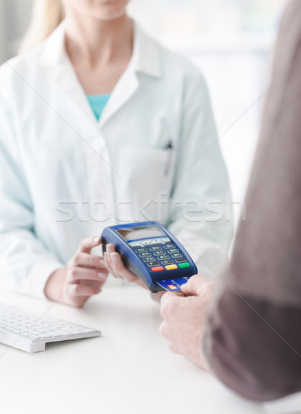 Man purchasing products in the pharmacy Stock photo © stokkete