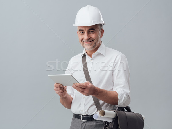 Architect using a digital tablet Stock photo © stokkete