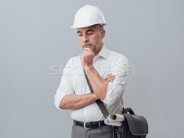 Thoughtful construction engineer Stock photo © stokkete