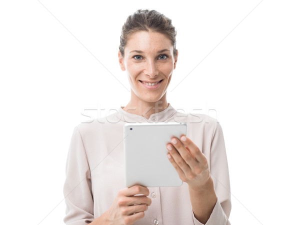 Nő érintőképernyő tabletta mosolyog vonzó nő kapcsolódik Stock fotó © stokkete