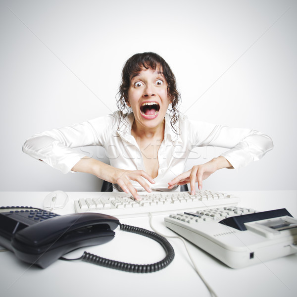 Female secretary crazed from overwork Stock photo © stokkete