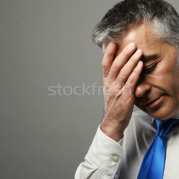 Hangsúlyos üzletember portré középső kor menedzser Stock fotó © stokkete