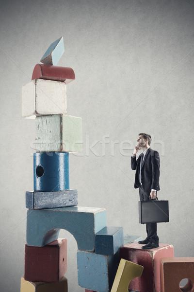 üzletember mászik siker köteg fa játék kockák Stock fotó © stokkete