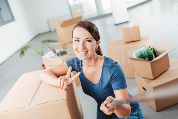 Woman taking a self portrait in her new house Stock photo © stokkete