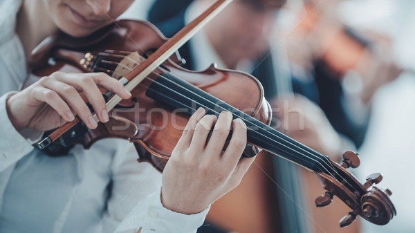 Stock photo: Talented violinist playing with orchestra
