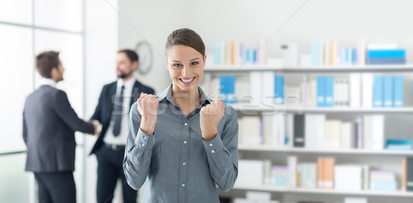 Cheerful businesswoman with raised fists Stock photo © stokkete