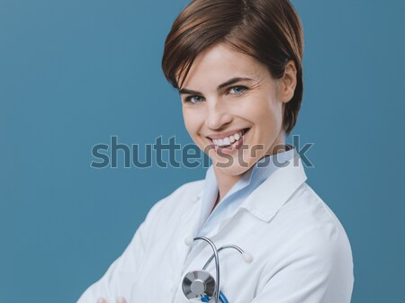 Smiling female doctor looking at camera Stock photo © stokkete