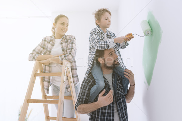 Family painting walls together Stock photo © stokkete