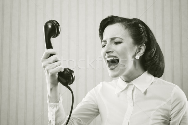 Young Woman shouting into telephone Stock fotó © stokkete