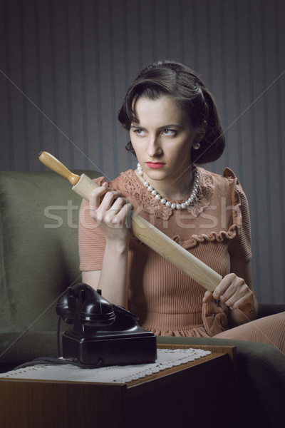 Stock photo: Angry wife waiting for her husband