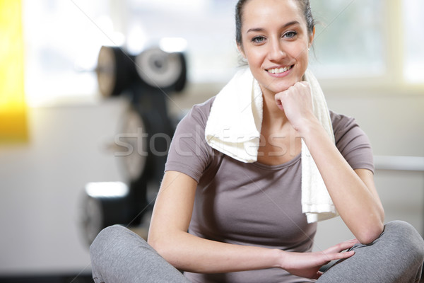 young woman sitting on the gym's floor after workout Stock photo © stokkete