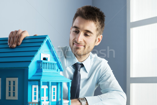 Real estate agent with model house Stock photo © stokkete