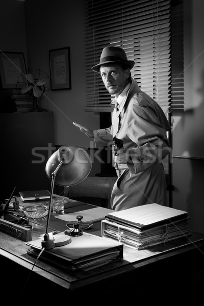 Vintage detective pointing a gun Stock photo © stokkete