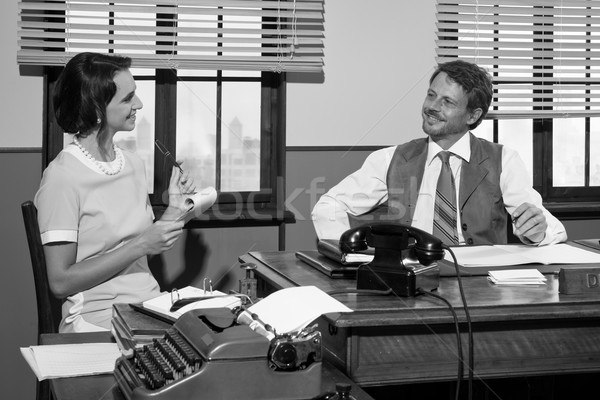 Vintage director and secretary working together at desk Stock photo © stokkete