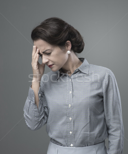 Vintage woman with headache Stock photo © stokkete