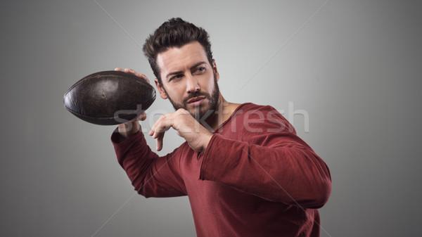 Football player launching ball Stock photo © stokkete