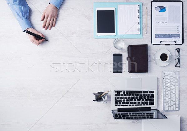Creative businessman working at office desk  Stock photo © stokkete