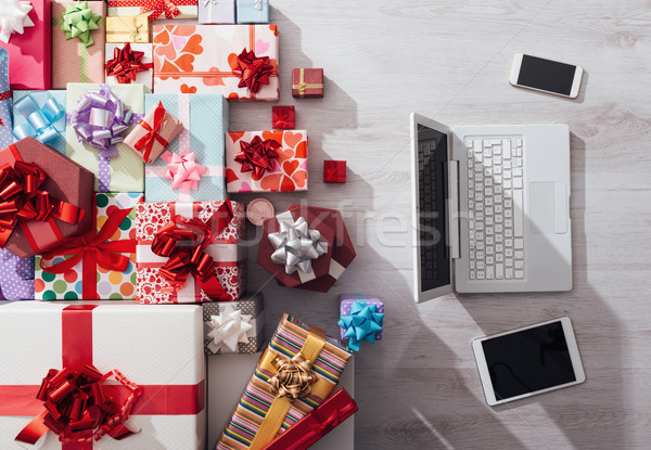 Laptop and plenty of gifts Stock photo © stokkete
