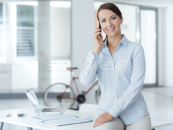 Smiling business woman having a phone call Stock photo © stokkete