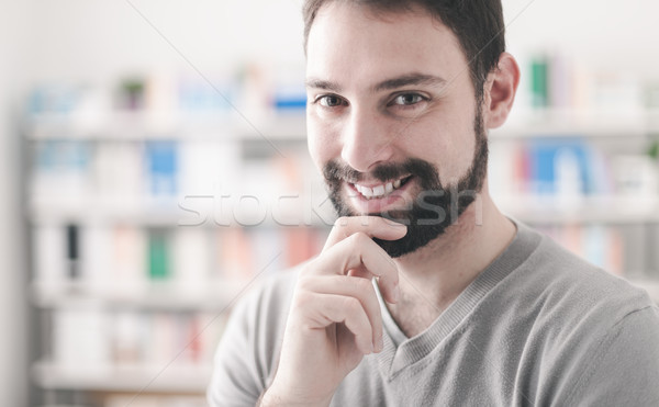 Confident man with hand on chin Stock photo © stokkete