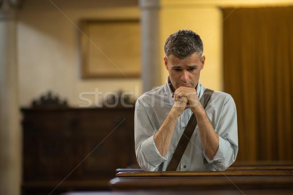 Homem oração igreja fé religião Foto stock © stokkete