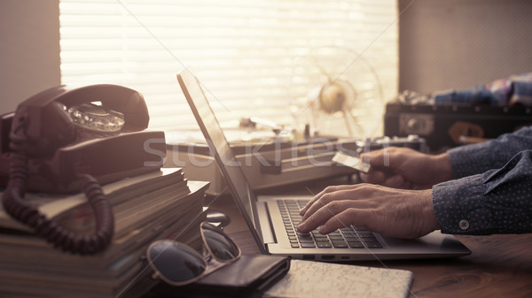 Man booking a vacation online with a credit card Stock photo © stokkete