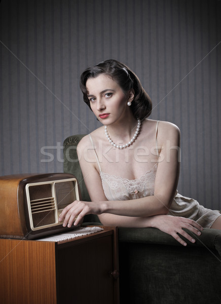 Sensual woman listening music on old radio Stock photo © stokkete