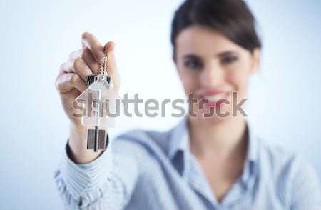 Holding out house keys Stock photo © stokkete
