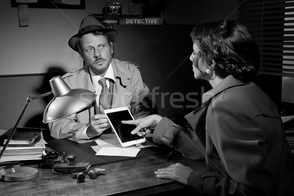 Woman using detective tablet at police department Stock photo © stokkete