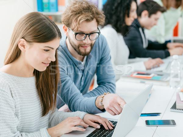 University students studying together Stock photo © stokkete