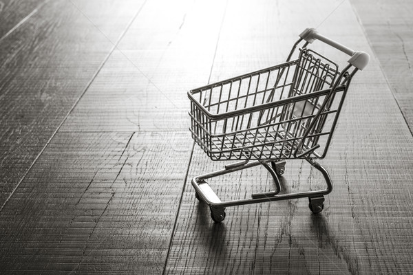 Miniature shopping cart on a desk Stock photo © stokkete