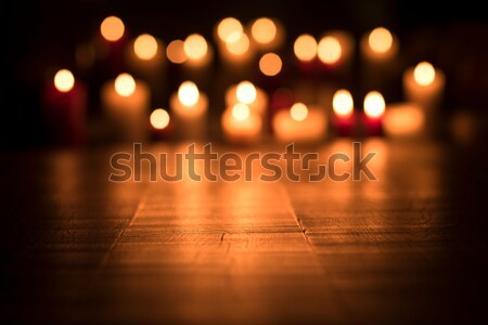 Lit candles burning in the Church Stock photo © stokkete