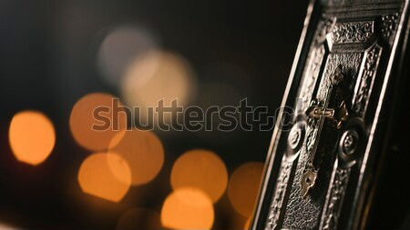Precious old Bible and lit candles in the Church Stock photo © stokkete