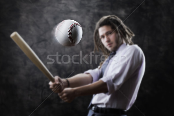 Businessman swinging baseball bat Stock photo © stokkete