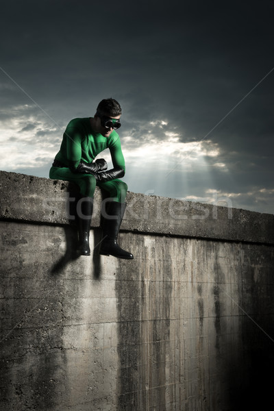 Superhero with dramatic sky on background Stock photo © stokkete