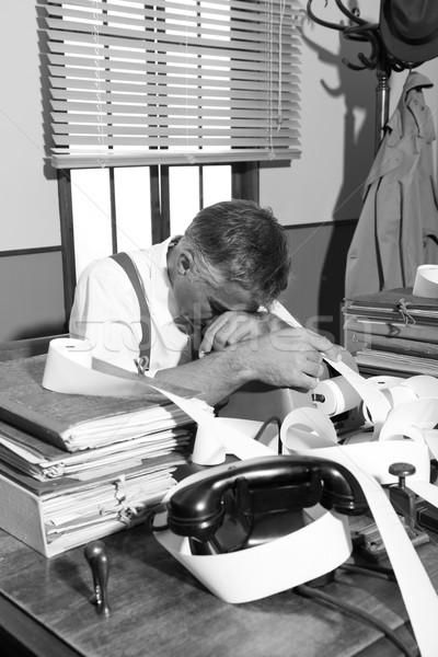 Tired overworked accountant in office, 1950s style Stock photo © stokkete