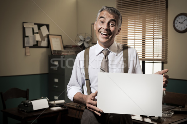 Smiling vintage businessman holding a blank sign Stock photo © stokkete