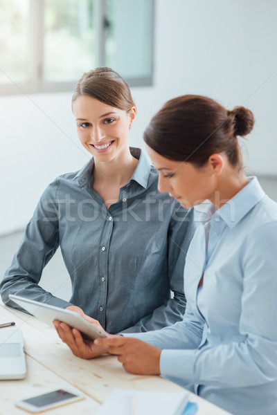 Business women working together with a tablet Stock photo © stokkete