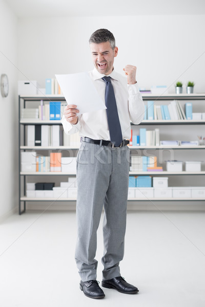 Cheerful businessman receiving good news Stock photo © stokkete
