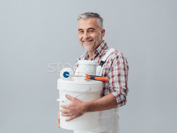 Painter posing with work tools Stock photo © stokkete