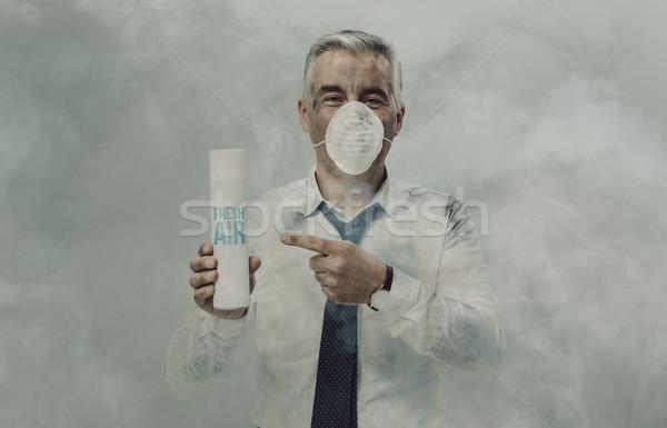 Businessman advertising a spray air purifier Stock photo © stokkete