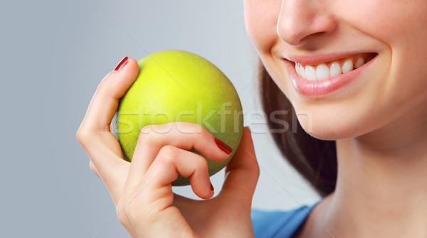 Yeşil elma beyaz diş genç kadın Stok fotoğraf © stokkete