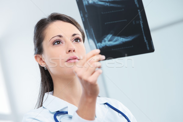 Female doctor examing an x-ray Stock photo © stokkete