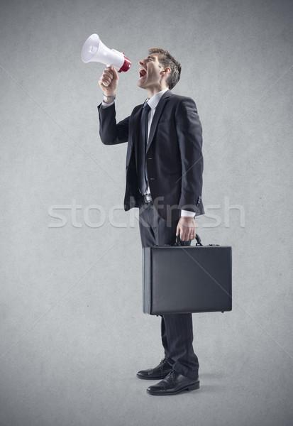 üzlet kommunikáció fiatal üzletember kiált megafon Stock fotó © stokkete