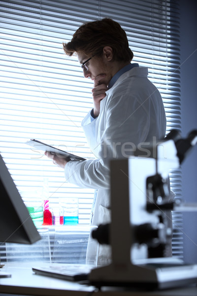 Researcher reading medical records Stock photo © stokkete
