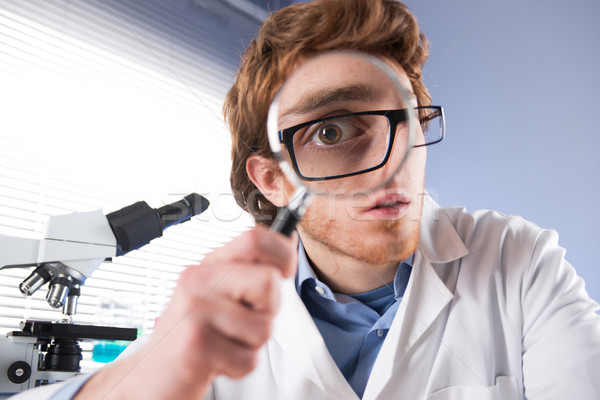 Young researcher with magnifier Stock photo © stokkete