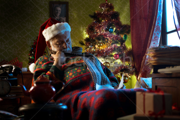 Santa Claus napping on his armchair Stock photo © stokkete
