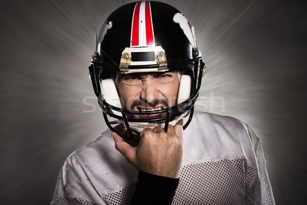 футболист шлема агрессивный позируют спорт фитнес Сток-фото © stokkete