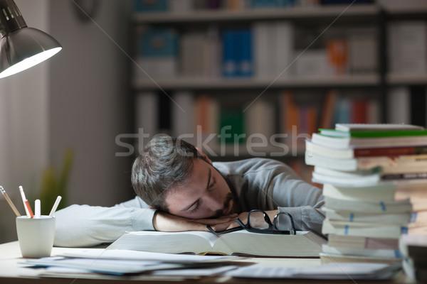 Férfi alszik asztal fiatalember késő éjszaka Stock fotó © stokkete